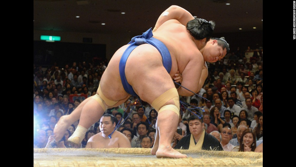 Kotoshogiku, front, pushes Endo to win a match on Wednesday, September 17 — Day 4 of the Grand Sumo Autumn Tournament in Tokyo.