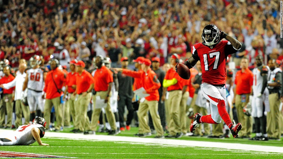 Atlanta Falcons punt returner Devin Hester high-steps into the end zone — Deion Sanders-style — to score a touchdown against Tampa Bay on Thursday, September 18, in Atlanta. The touchdown gave Hester 20 career touchdown returns, surpassing the NFL record he once shared with Sanders.