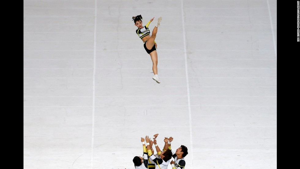 Cheerleaders perform during the opening ceremony of the Asian Games on Friday, September 19. The multisport competition will take place until October 4 in Incheon, South Korea.