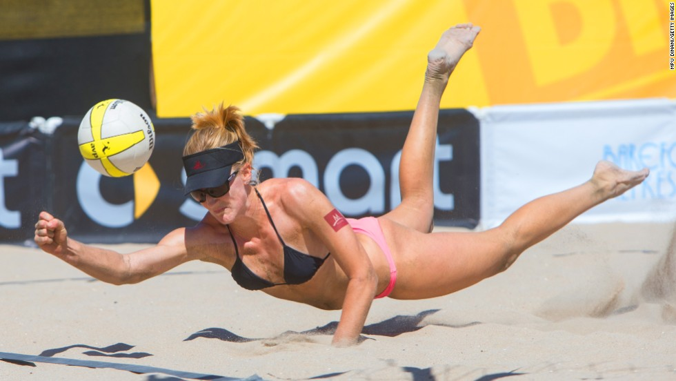 Beach volleyball player Emily Day dives for the ball Friday, September 19, during a match at the AVP Championships in Huntington Beach, California.