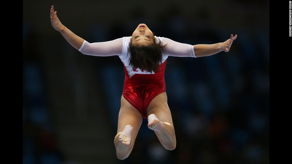 Japanese gymnast Akiho Sato leaps on the balance beam during qualifying Monday, September 22, at the Asian Games in Incheon, South Korea.