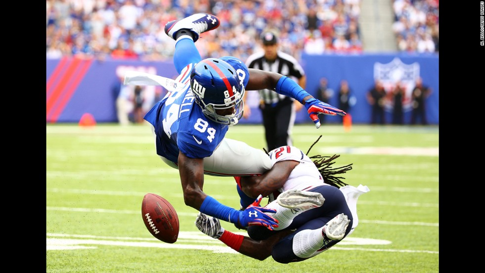 "Kendrick Lewis of the Houston Texans, right, hits New York Giants tight end Larry Donnell and forces a fumble during an NFL game Sunday, September 21, in East Rutherford, New Jersey. <a href=""http://www.cnn.com/2014/09/16/worldsport/gallery/what-a-shot-0915/index.html"">See 34 amazing sports photos from last week</a>"