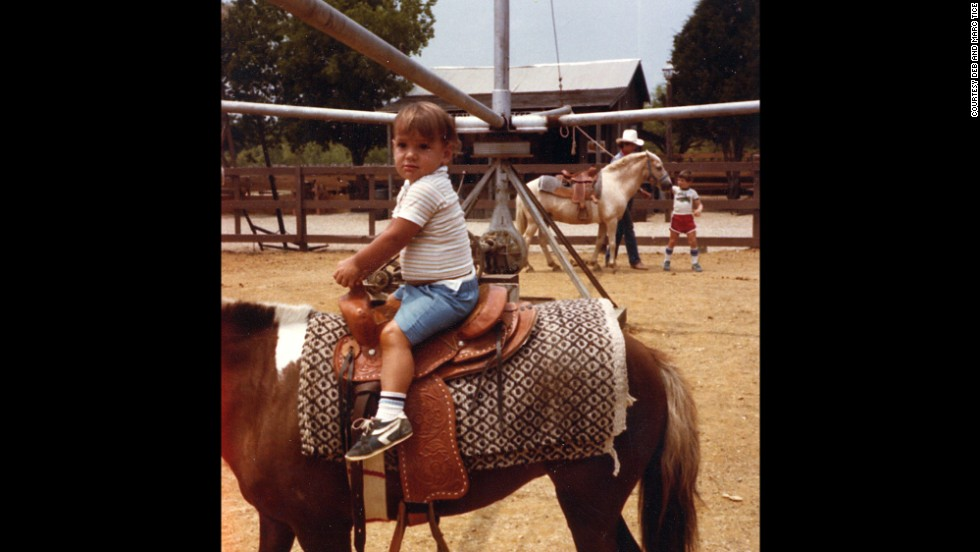 Tice wasn't one to shy away from first experiences, even at a young age. Here he is on his first horse ride.