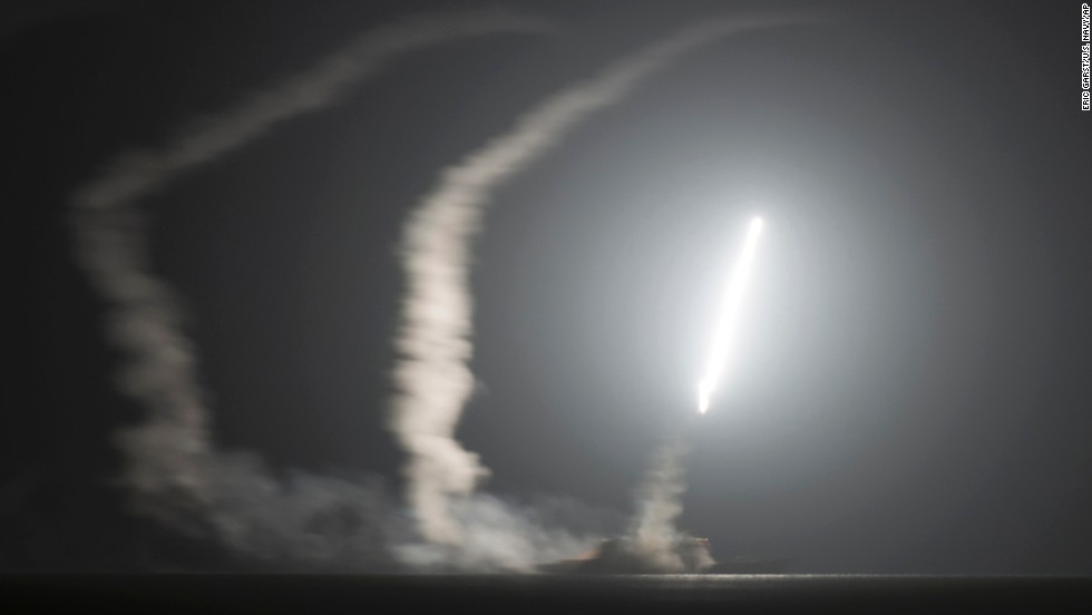 The USS Philippine Sea, a guided-missile cruiser with the U.S. Navy, launches a Tomahawk cruise missile from the Persian Gulf during an attack on ISIS positions on September 23. The U.S. Navy released this photo and several others following the airstrikes.