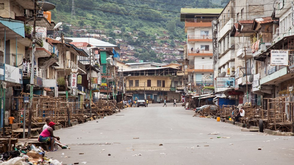 A few people are seen in Freetown during a three-day nationwide lockdown on September 21, 2014. In an attempt to curb the spread of the Ebola virus, people in Sierra Leone were told to stay in their homes.