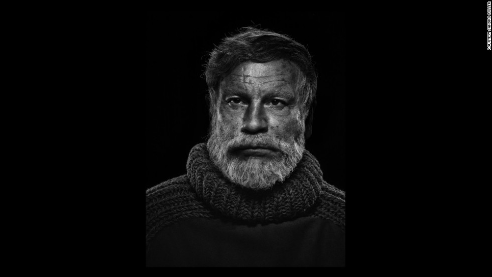 Malkovich poses as author Ernest Hemingway based on Yousuf Karsh's portrait of Hemingway in 1957.