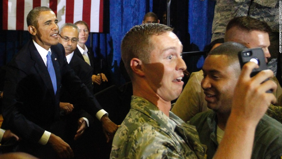 A U.S. service member takes a selfie Wednesday, September 17, after President Barack Obama, left, gave a speech at MacDill Air Force Base in Florida.