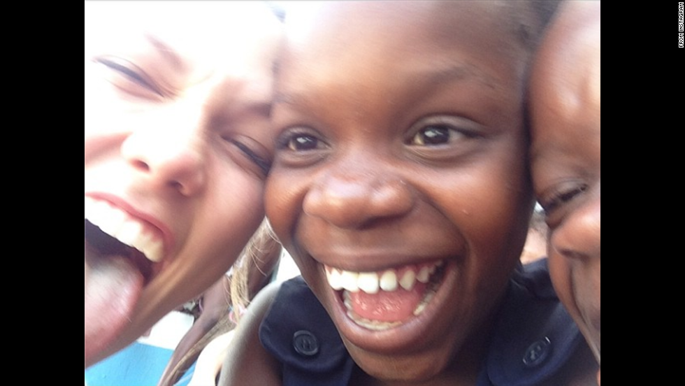 "Model Karlie Kloss, left, posted this selfie from a Haitian orphanage on Monday, September 22. ""Making new friends ... aaaaand making funny faces,"" <a href=""http://instagram.com/p/tRfkg1ESr9/"" target=""_blank"">she wrote on Instagram.</a>"