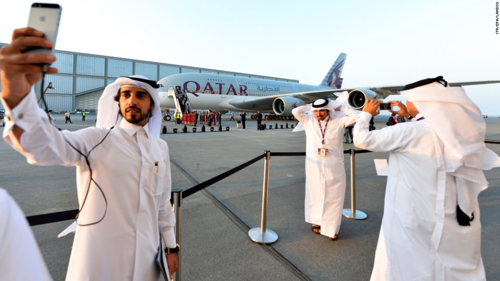 "A young Qatari takes a selfie with Qatar Airways' new Airbus A380 in the background after the ""superjumbo"" aircraft landed in Doha, Qatar, on Thursday, September 18."