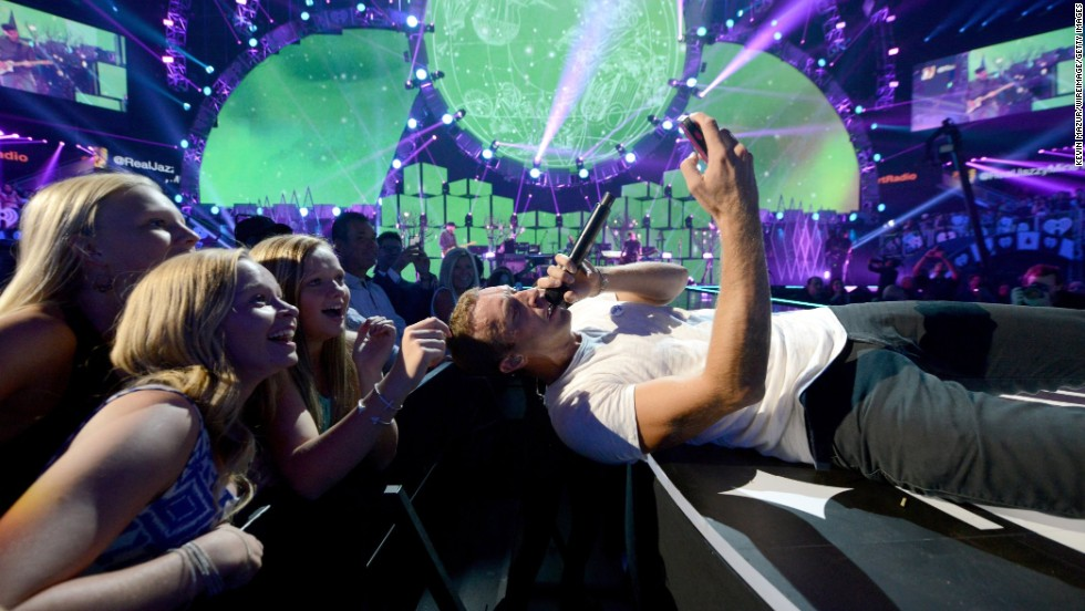Coldplay frontman Chris Martin snaps a selfie with fans during a performance in Las Vegas on Friday, September 19.