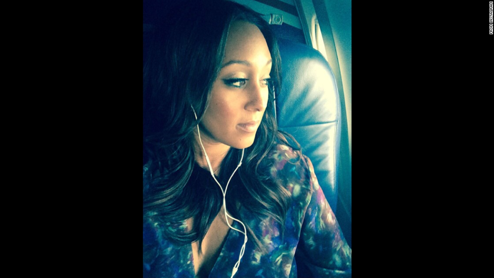 "Actress Tamera Mowry posted this <a href=""http://instagram.com/p/tQ8p0lM8TV/"" target=""_blank"">travel selfie</a> on Monday, September 22. ""LA Bound can't wait to embrace my babies,"" she said on Instagram."