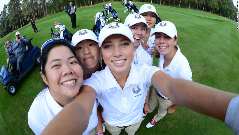 Golfer Sierra Brooks borrows a camera so she can take a selfie with her Team USA teammates on Sunday, September 21, during a practice round for the Junior Ryder Cup in Perth, Scotland.