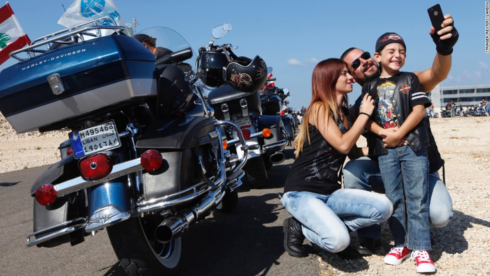 A family takes a selfie together during the Beirut Bike Festival in Beirut, Lebanon, on Sunday, September 21. More than 1,000 motorcycling enthusiasts took part in the event, which organizers say promotes safe and legal motorcycling habits in Lebanon.
