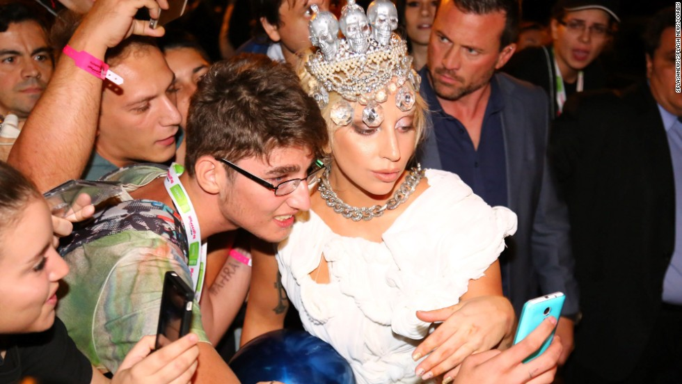 Lady Gaga poses with a fan at her hotel after a concert in Athens, Greece, on Saturday, September 20.