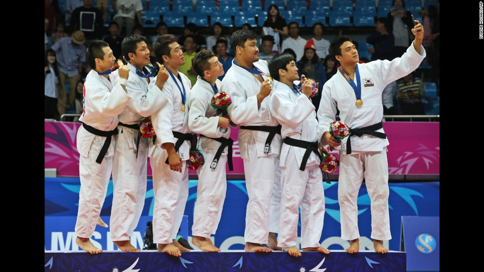 The South Korean judo team poses for a selfie Tuesday, September 23, after winning gold at the Asian Games in Incheon, South Korea.