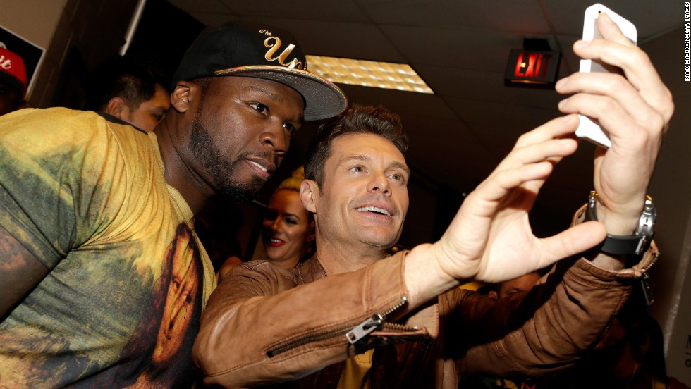 "Rapper 50 Cent, left, and television personality Ryan Seacrest take a photo together Saturday, September 20, at the iHeartRadio Music Festival in Las Vegas. <a href=""http://www.cnn.com/2014/09/17/world/gallery/look-at-me-0917/index.html"">See 22 selfies from last week</a>"