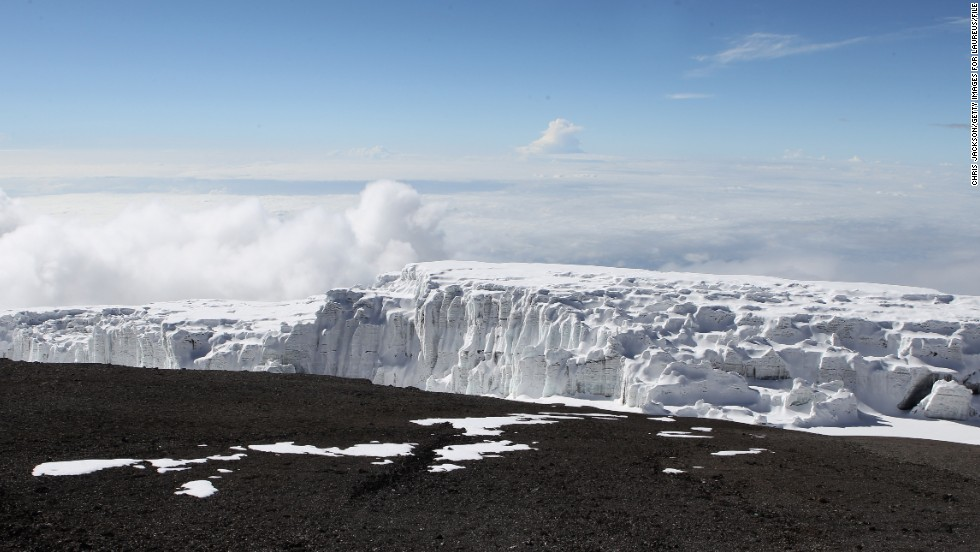 The snows capping majestic Mount Kilimanjaro, Africa's highest peak, once inspired Ernest Hemingway. Now they're in danger of melting away altogether. Studies suggest that if the mountain's snowcap continues to evaporate at its current rate, it could be gone in 15 years. Here, a Kilimanjaro glacier is viewed from Uhuru Peak in December 2010.