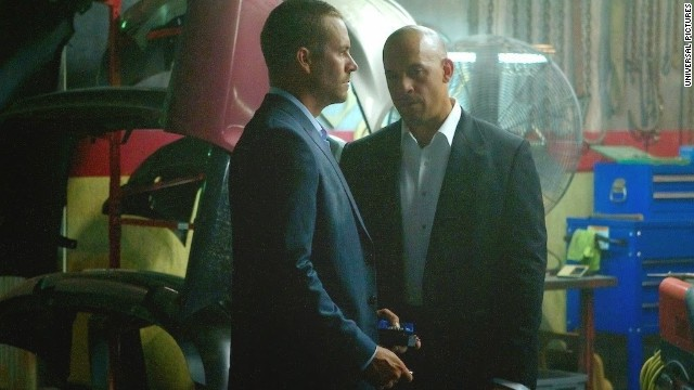 "Vin Diesel, right, shared a photo of Paul Walker in the upcoming ""Fast & Furious 7"" on Facebook on Tuesday."