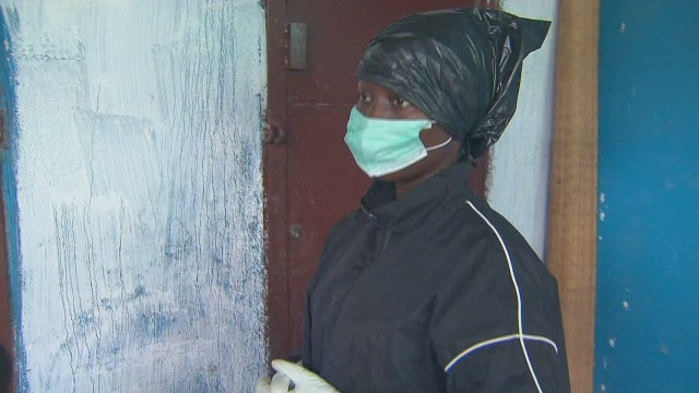 Woman cares for her family with Ebola