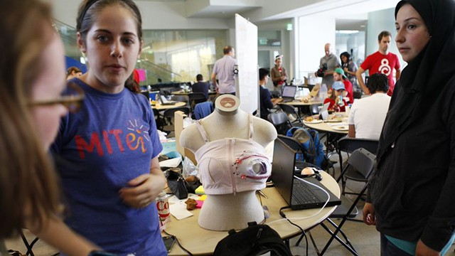 "A group works on their alternative pump at the ""Make the Breast Pump Not Suck"" hackathon at MIT."