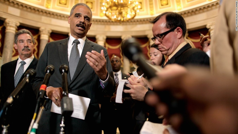 "Holder talks to reporters after meeting with U.S. Rep. Darrell Issa, chairman of the House Oversight and Government Reform Committee, in June 2012. Issa and Holder met to discuss releasing documents related to the botched <a href=""http://www.cnn.com/2013/08/27/world/americas/operation-fast-and-furious-fast-facts/"">Fast and Furious</a> investigation."