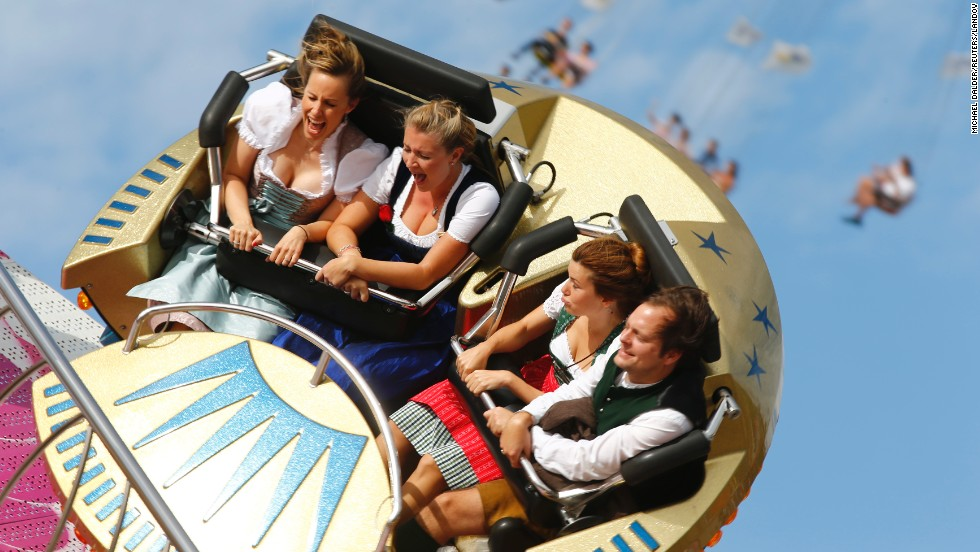 Festivalgoers enjoy an amusement ride Saturday, September 20, on the opening day of Oktoberfest in Munich, Germany. Millions of beer drinkers from around the world will be attending the event, which runs through October 5.