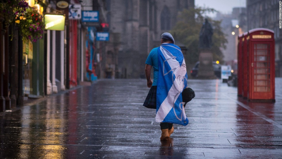 "A supporter of Scottish independence walks down a street in Edinburgh, Scotland, on Friday, September 19, after it was confirmed that a majority of <a href=""http://www.cnn.com/2014/09/18/europe/gallery/scotland-independence-vote/index.html"">Scottish voters</a> -- 55% to 45% -- rejected a proposal to break away from the United Kingdom."