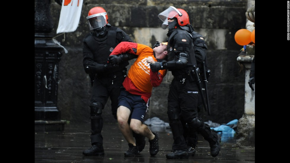 Police officers in Azpeitia, Spain, detain a man Monday, September 22, as he and around 200 people protested the arrest of five people suspected of being part of SEGI, a Basque pro-independence youth organization.