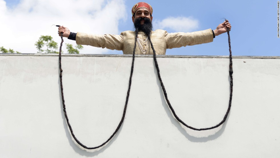 Ram Singh Chauhan shows off his 18-foot mustache Wednesday, September 24, in Ahmedabad, India. It is the world's longest mustache, according to the Guinness Book of World Records.