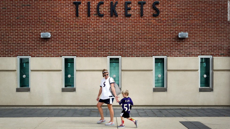 Kristen Moyer gives her son a five after they traded in his jersey of Baltimore Ravens running back Ray Rice on Friday, September 19. The Ravens allowed fans to trade in their Rice jerseys and get another player's jersey for free after Rice was cut by the team and suspended by the NFL for domestic violence.