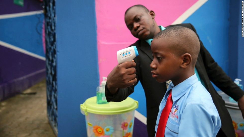 "A school official takes a student's temperature with an infrared laser thermometer Monday, September 22, in Lagos, Nigeria. Health officials say <a href=""http://www.cnn.com/2014/04/04/world/gallery/ebola-in-west-africa/index.html"">the Ebola outbreak in West Africa</a> is the deadliest ever. As of September 21, the total number of probable, confirmed and suspected cases of Ebola was more than 6,000, with nearly 3,000 deaths, the World Health Organization said."