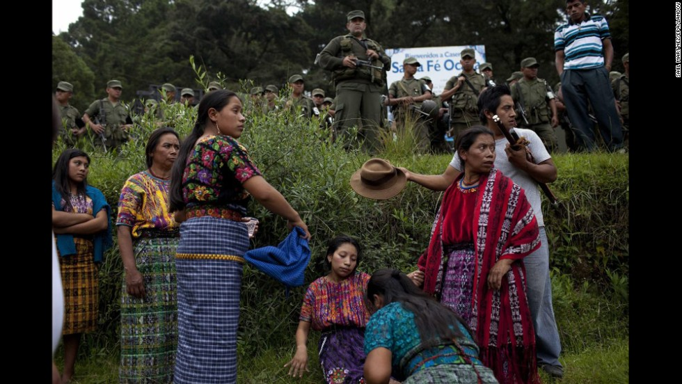 On Monday, September 22, people bury relatives who recently died in clashes over a cement factory in the Guatemalan municipality of San Juan Sacatepequez. The Guatemalan government has ordered a state of emergency for the municipality, where at least eight people have died in clashes between those who support the factory's operation and those who reject it.