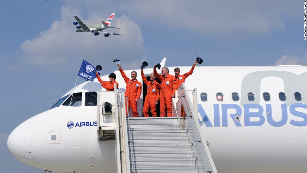 The crew of the Airbus A320neo waves to observers in Blagnac, France, after the plane's first test flight on Thursday, September 25. The A320neo is the revamped and more fuel-efficient version of Airbus' most popular single-aisle passenger jet.