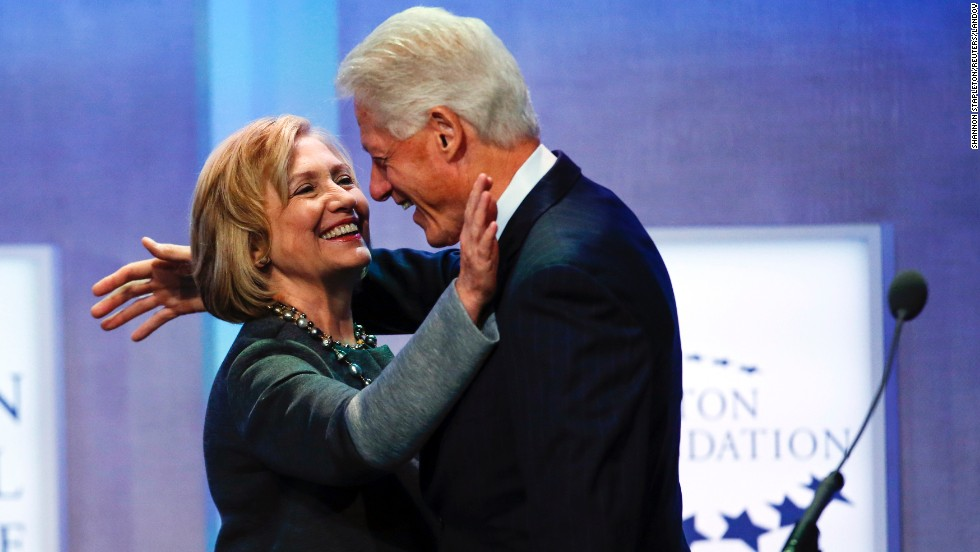 "Former U.S. President Bill Clinton and his wife, former U.S. Secretary of State Hillary Clinton, embrace Monday, September 22, during a session at the Clinton Global Initiative in New York. The Clinton Global Initiative <a href=""http://www.cnn.com/2014/09/25/politics/bill-clinton-cgi/index.html"">was founded in 2005</a> to bring together world leaders to discuss and implement solutions to the world's problems, Bill Clinton said at the time."