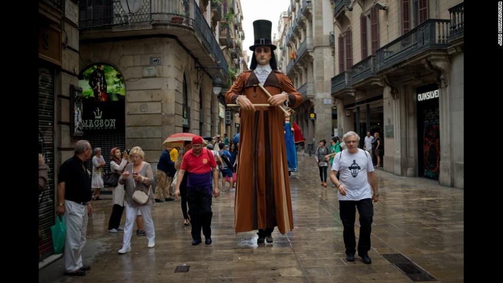 A performer dressed as a Catalan giant walks through the streets of Barcelona, Spain, for the La Merce festival on Wednesday, September 24.