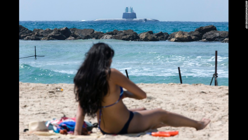 Israel's new submarine, the INS Tanin, is seen from a beach in Haifa, Israel, on Tuesday, September 23. The sub was making its final approach into Haifa's port after being built in Germany.