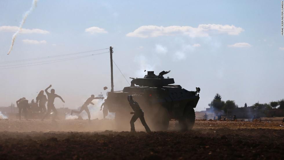 "Turkish Kurds clash with Turkish security forces during a protest near Suruc, Turkey, on Monday, September 22. According to <a href=""http://time.com/3423522/turkey-syria-isis-isil-refugees/"" target=""_blank"">Time magazine,</a> the protests were over Turkey's temporary decision to close the border with Syria. <a href=""http://www.cnn.com/2014/09/19/world/gallery/week-in-photos-0919/index.html"">See last week in 31 photos</a>"