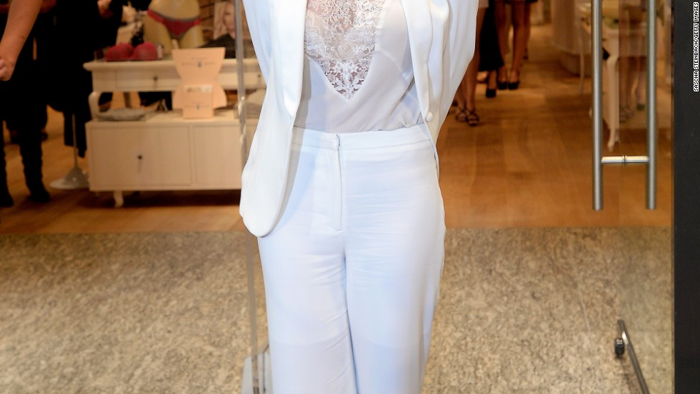 Britney Spears doesn't look too sure as she presents her line of intimates at a store in Germany on September 25.