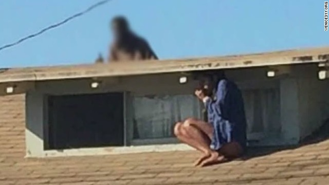 Woman hides on roof during home invasion