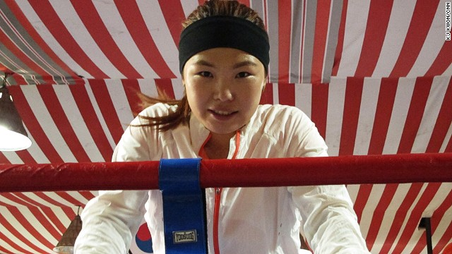 Choi takes a short break after sparring session. Choi, who defended featherweight title for the seventh time, says the biggest challenge for her now is finding the right sponsor.