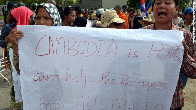 Cambodians protest a deal to take refugees in front of the Australian embassy in Phnom Penh.
