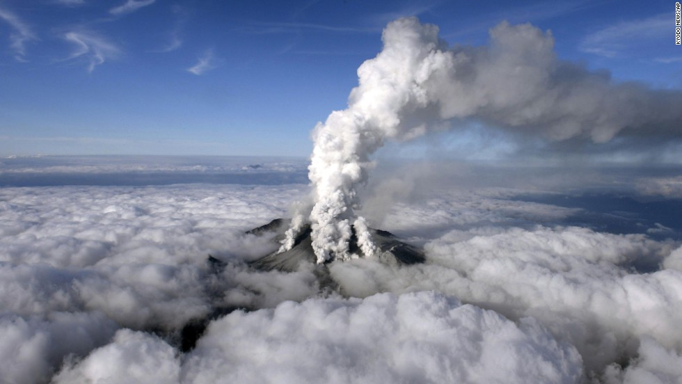 Dense white plumes rise high in the air as Mount Ontake erupts in central Japan in September 2014.
