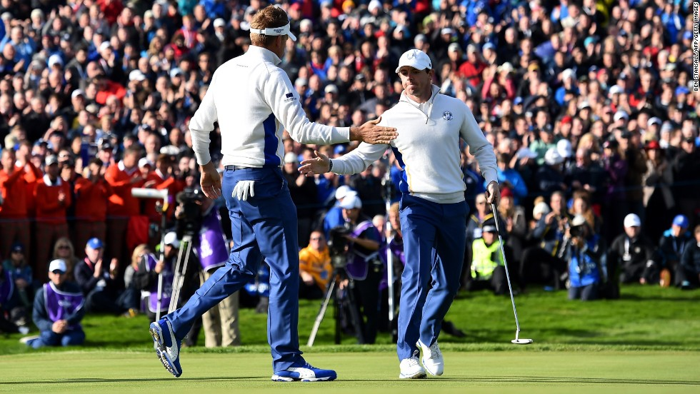 Europe's Rory McIlroy (right) and Ian Poulter claimed a vital half point against Jimmy Walker and Rickie Fowler in the morning fourballs on Saturday.