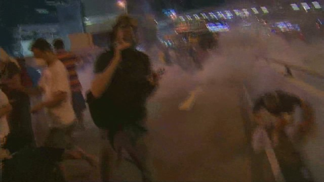 CNN reporter, crowd hit with tear gas