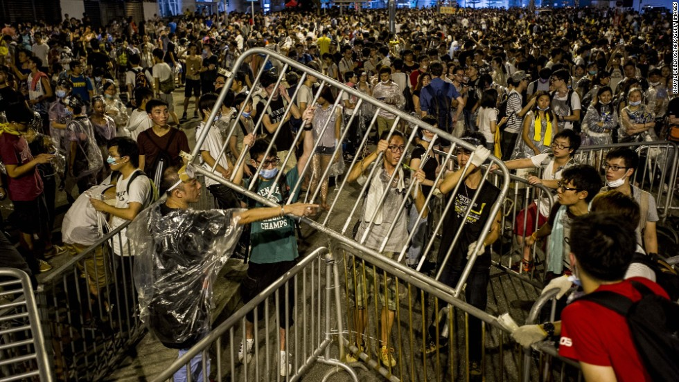 Protesters tie up barricades on September 28 during a demonstration outside the headquarters of the Legislative Council in Hong Kong.