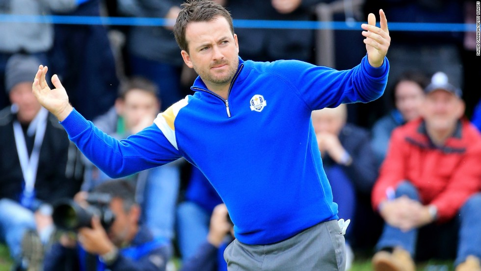 Graeme McDowell trailed U.S. rookie Jordan Spieth early in their singles match but he hit back for a pivotal victory.