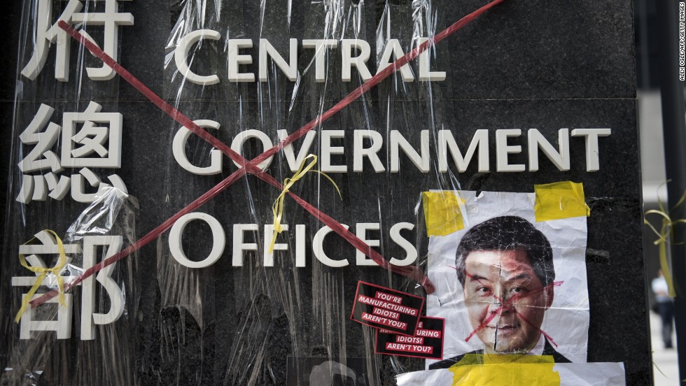 A sign for the Hong Kong central government offices has been crossed out with red tape by democracy activists on September 28.