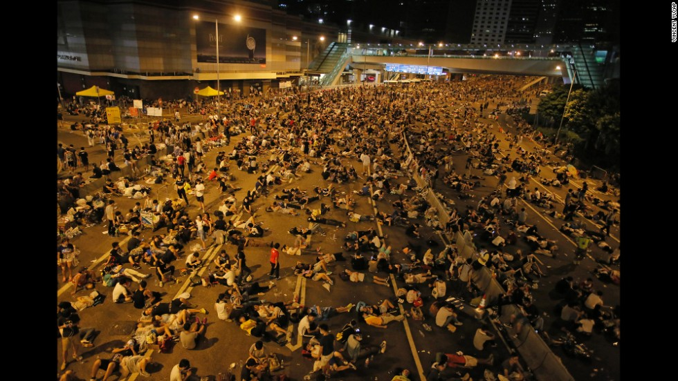 Protesters occupy a main road in the Central district of Hong Kong after riot police used tear gas against them on Sunday, September 28.