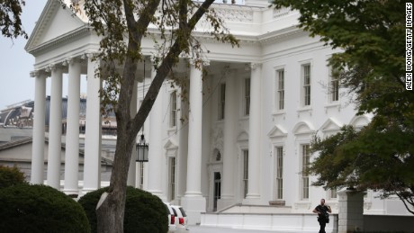 WASHINGTON, DC - SEPTEMBER 29:  A member of the U.S. Secret Service patrols outside the North Portico of the White House September 29, 2014 in Washington, DC. Omar Gonzalez, the man arrested on Friday after jumping the White House fence, went deeper into the building than what it was previously reported.  (Photo by )