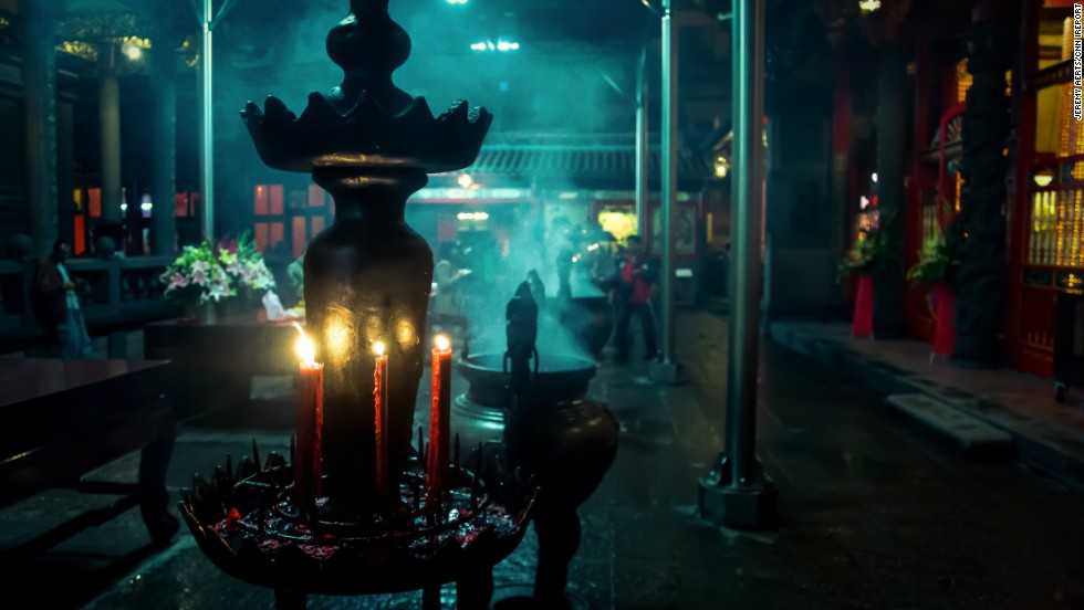 "Incense and candles set the mood at <a href=""http://ireport.cnn.com/docs/DOC-1152367"">Longshan Temple</a> in Taipei, Taiwan. Walking through the temple ""felt as if I traveled back hundreds of years to a time long forgotten,"" said Jeremy Aerts."